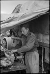 G A O'Loughlin prepares a turkey for Christmas dinner in Italy, World War II - Photograph taken by George Kaye
