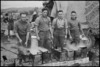 Cooks preparing Christmas dinner in the NZ Division area in Italy, World War II - Photograph taken by George Kaye