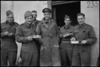 New Zealand personnel eating Christmas dinner in the NZ Sector of the Italian Front, World War II - Photograph taken by George Kaye