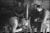Staff of NZ Reinforcement Unit installing a stove inside their tent, Italian 5th Army Front, World War II - Photograph taken by George Bull