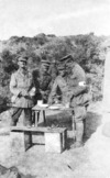 Four soldiers standing around a table eating, Gallipoli, Turkey