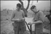 D A Robertson and D Davies, of NZ Infantry, rest behind the lines on the Cassino Front, Italy, World War II - Photograph taken by George Kaye