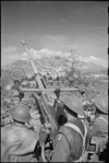 Allied anti aircraft crew watches for enemy aircraft in the mountainous country on the Italian Front, World War II - Photograph taken by George Kaye