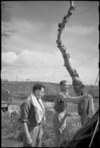 J H Ransome and J B Rodgers attend to their washing on the Italian Front, World War II - Photograph taken by George Kaye