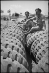 P T Hurren and G F McClure sit on large tyres close to forward areas of the Cassino Front, Italy, World War II - Photograph taken by George Kaye