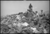 Pile of winter clothing handed in by 2 NZ Division personnel in exchange for summer clothing, Italy, World War II - Photograph taken by George Kaye