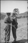 Lieutenant Colonel R R T Young, OC NZ Maori Battalion, presented with DSO by General Freyberg, Volturno Valley, Italy, World War II - Photograph taken by George Kaye
