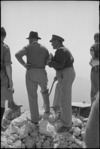 Prime Minister Peter Fraser and General Bernard Freyberg look down on ruins of Cassino, Italy, World War II - Photograph taken by George Kaye