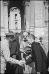 Prime Minister Peter Fraser introducing General Bernard Freyberg to Father John Flanagan in Rome, Italy, World War II - Photograph taken by George Bull