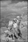 Members of 22 NZ Battalion billetted in ruins of castle overlooking Vicalvi, Italy, World War II - Photograph taken by George Kaye
