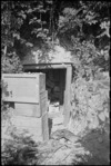 Concealed entrance to German dug-out in town of Orsogna, Italy, World War II - Photograph taken by George Kaye