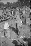 W I M Baker winning the wood chopping event at 5 NZ Field Regiment Gymkhana, Arce, Italy, World War II - Photograph taken by George Bull