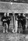 Men with violins, a harp and cello