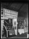 Stands at a trade fair in 1930, advertising Taradale Vineyards, Hawkes Bay, and Women's Institutes & Home Handicrafts Ltd