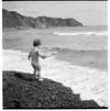 Children playingat a beach, possibly at Makara