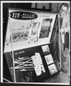 National Publicity Studios artist-designer Peter Read with a portable display case for overseas exhibitions
