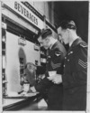 New Zealand airmen getting drinks from an American beverage station