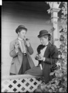Gertie Tewsley smoking a pipe with Ethel Haggitt