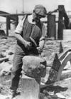 John Barr chiseling a stone for E S Wilkinson's house, North Taranaki