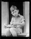 Robert Wells sitting on step with toy truck