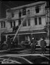 Firemen putting out fire at Smith and Smith Ltd, Cuba Street, Wellington