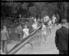 Australian men's eights team carrying boat to water, 1950 British Empire Games, Lake Karapiro