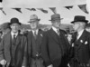 Four men at a reunion of Mount Cook School
