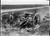 A New Zealand 18 pounder gun in action at Beaussart, France, during World War I