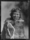 Marutuna of Orakeikorako dressed in a feather cloak
