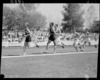 Eighth lap of the men's three mile race at the 1950 British Empire Games, Eden Park, Auckland