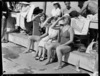 Spectators and team members poolside watching a dive, 1950 British Empire Games, Auckland