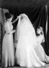 Woman in a bridal gown and veil, with Phyllis Fell
