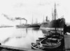 Muir and Moodie, fl 1898-1916 (Firm, Dunedin) :Photograph of boats and ships at wharves in Dunedin