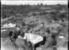 New Zealand officers eating breakfast in captured German trenches