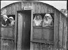 Nurses look out of the windows of the New Zealand Stationary Hospital, Wisques, France, during World War 1