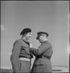 Colonel S F Hartnell receives the DSO from General Freyberg at Maadi, World War II - Photograph taken by M D Elias