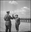 Sergeant W Goodmanson receives the Military Medal from General Freyberg at Maadi, World War II - Photograph taken by M D Elias