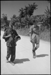 Enemy prisoner, captured near Sora, Italy, is brought along the road - Photograph taken by George Kaye