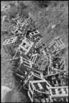 Heap of enemy mine crates in the Balsorano area, Italy, World War II - Photograph taken by George Kaye
