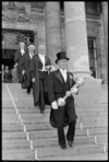 Dr Gerald Wall, the new speaker, being led down the steps of Parliament - Photograph taken by Ross Giblin