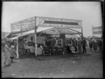 Farming field day booth of Jas J Niven & Co Ltd of Napier, showing their agricultural equipment and domestic appliances, Hawke's Bay District
