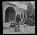 Edgar Williams with a push bike outside house with front brick entrance, [Christchurch]