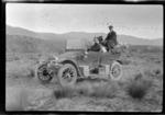 Three men [Edgar Williams, W A Kennedy and T A Fletcher?], in a motorcar, Mackenzie District