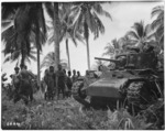 Locals taking an interest in a tank, Nissan Island, Papua New Guinea, during World War 2