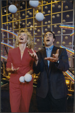 Lotto draw presenters Hilary Timmins and Grant Kereama juggling balls - Photograph taken by Mark Coote