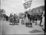 """Group including """"John Bull"""" in fancy dress during the Armistice Day celebrations in Levin"""