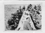 Members of the 28 (Maori) Battalion eating Christmas Dinner in the desert, Nofilia, Libya - Photograph taken by Dr C N D'Arcy