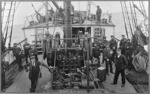 Foredeck of the ship Tutanekai, with sailors alongside the cable winch