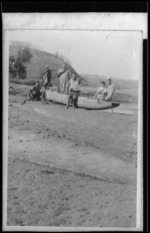 Fishing waka being launched on Papatapu Creek, Aotea Harbour, north of Kawhia