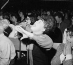 Fans demonstrating during Beatles' concert at Wellington Town Hall